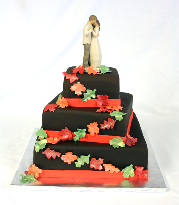 Chocolate wedding cake with leaves