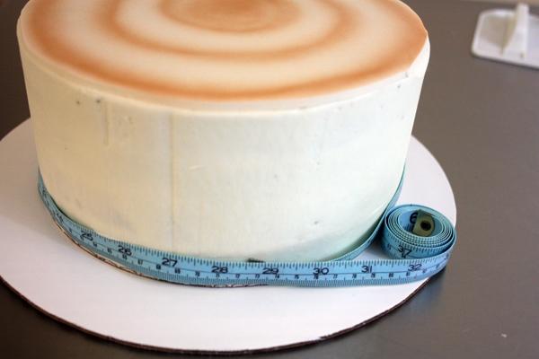 Birch Tree Winter Wedding Cake - measuring the circumference of the cake