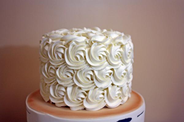 Birch Tree Winter Wedding Cake - piping the top tier