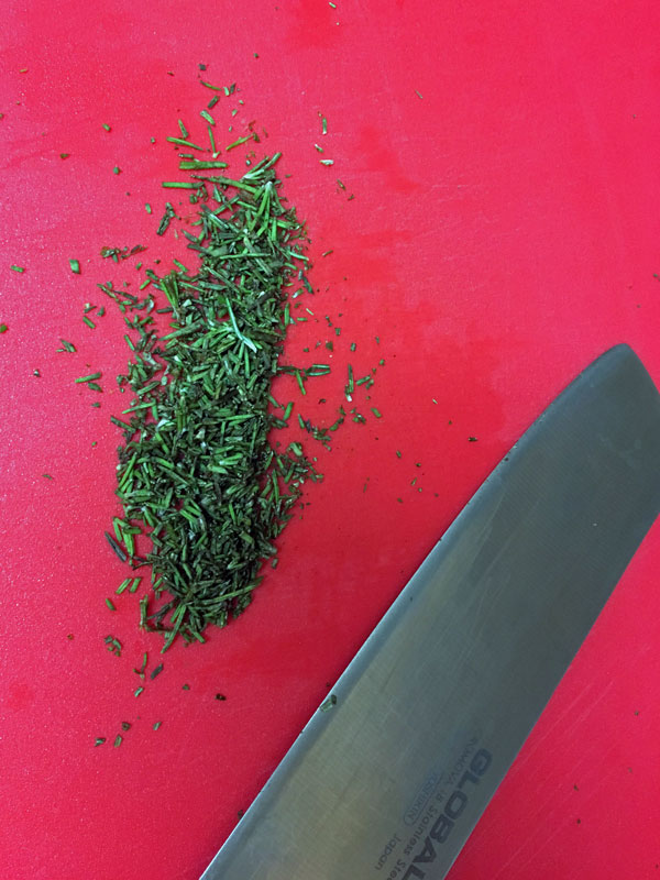 Chopping the rosemary