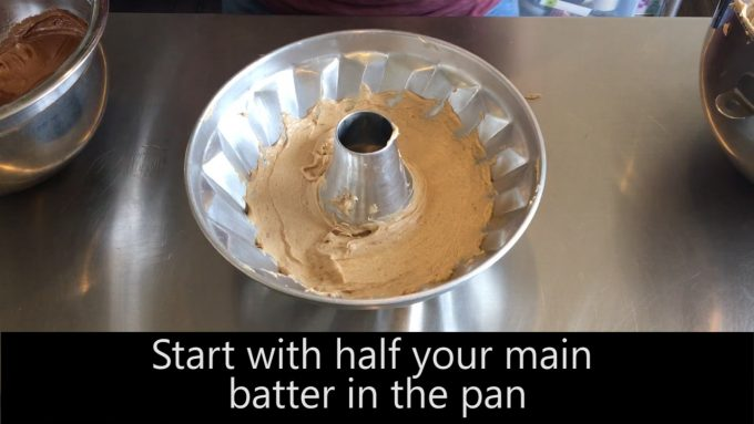 Start with half your main batter in the pan